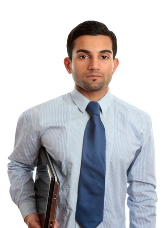 A businessman, IT consultant or IT technician wearing shirt and tie and holding a laptop computer.  White background. photo