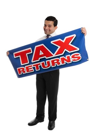 refund: A smiling accountant, auditor or businessman holding a sign Tax Returns.   White background.