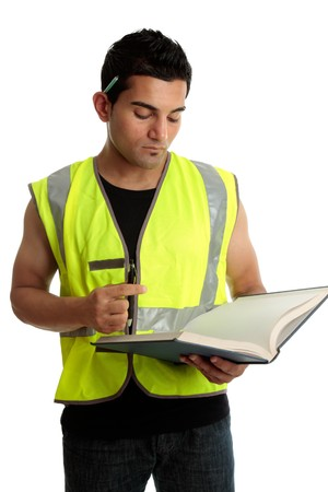 italian ethnicity: Construction worker with a book or a construction student apprentice studying learning.  White backgrond.