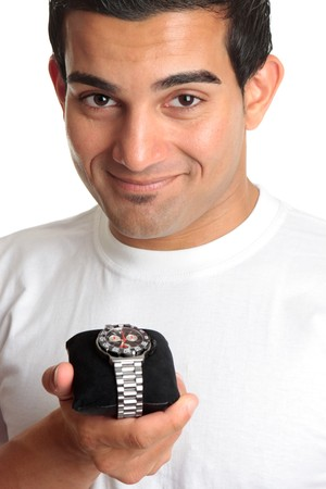 italian ethnicity: A smiling man holding a chronograph wrist watch with metal bracelet.  White background. Stock Photo