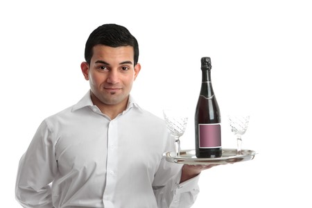 A cafe or restaurant waiter or barman carrying a tray with wine and glasses.  White background. photo