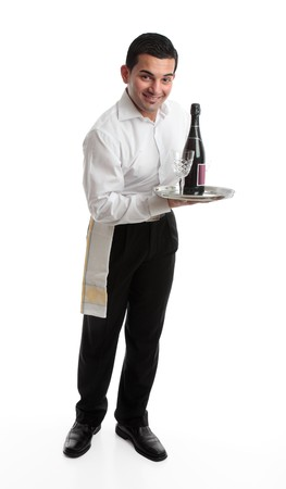 A smiling friendly waiter, bartender, or domestic staff, holding or presenting a tray with a bottle of  wine and glasses.  White background. photo