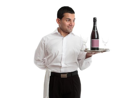 A waiter, servant or bartender looking at a wine product on a silver tray and smiling.  White background. photo