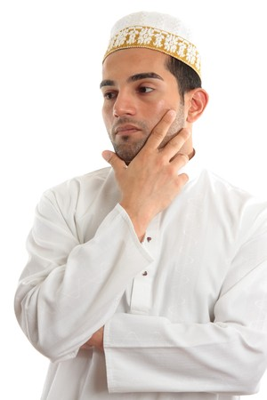thoub: An ethnic mixed race man.  He has a serious pondering, thinking, thoughtful expression and looking off sideways.  Dressed in traditional middle eastern clothing and topi.  White background, suitable for copy