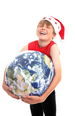 A happy boy hugging the earth globe, rejoices at the good news of Christmas.  Focus to globe photo