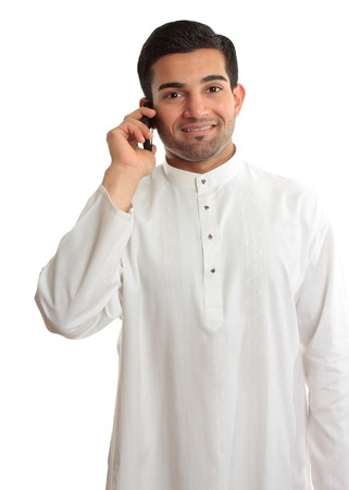 qameez: Smiling ethnic business man using a mobile phone and in traditional ethnic robe - Kurta - fastened with ruby buttons. The name Kurta is a borrowing from Urdu and Hindi,and originally from Persian (literally, a collarless shirt).