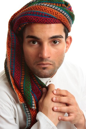 thoub: Mixed race middle eastern ethnic man wearing a robe and wovan turban keffiyeh