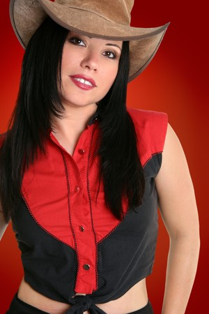 country western: Female wearing a rugged leather hat and black with red country western clothing Stock Photo