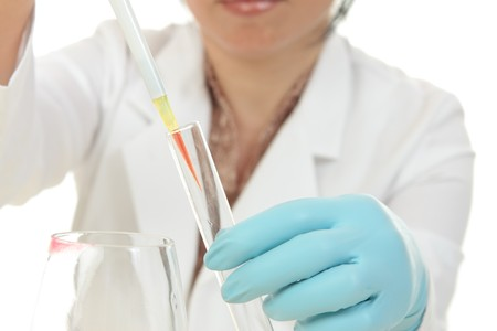 A female forensic scientist at work. photo
