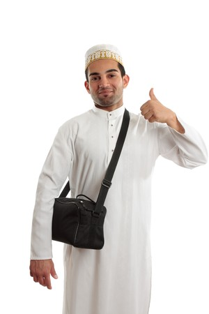 thoub: Happy ethnic arab man showing a thumbs up hand sign.  White background.