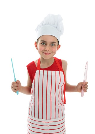 A little chef or cook holding two knives with safety covers.  White background. photo