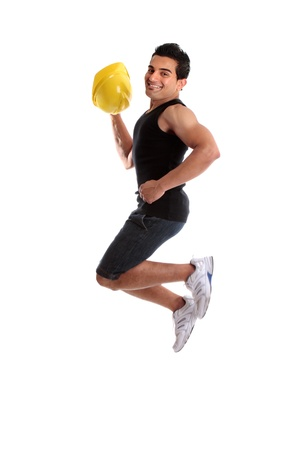 A male construction worker, builder or other tradesman jumping into the air.  White background. photo