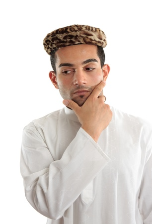 kameez: Deep thinking man with one hand on chin.  Looking down and sideways - space for copy.  White background. Stock Photo