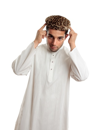 kameez: An ethnic man in white embroidered robe and a leopard fur topi hat.