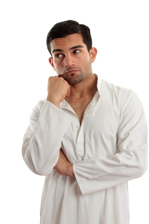 A man in a thinking pose and looking up and right.  For most people looking up and  right means a person is constructing a picture. Visual processing takes in lots of information data. This means they are often adept at seeing the big picture and long-ran Stock Photo - 8421272