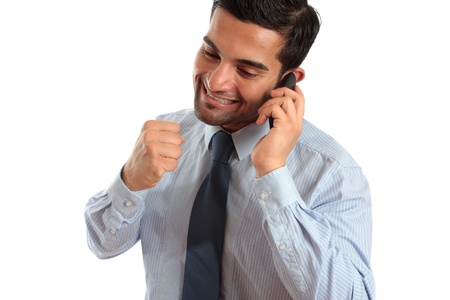 italian ethnicity: A very happy businessman or salesman on a telephone call and making a fist of success or achievement.  Sales deal, new job, promotion etc.