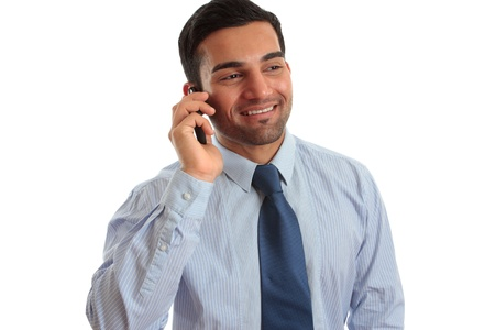 A smart happy businessman in conversation on  a mobile phone cellphone. White background. photo