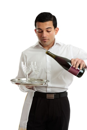 A waiter, servant or bartender serving alcohol wine from a bottle into wine glasses. Stock Photo - 8468416