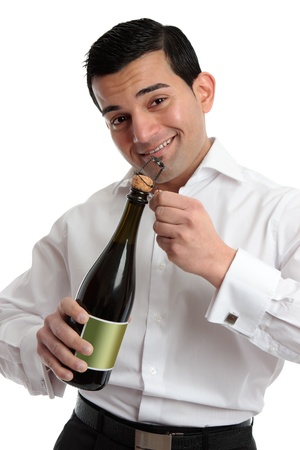 A cheerful bartender or man celebrating by opening a bottle of sparkling wine or champagne.  White background. Stock Photo - 8468418