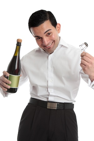 A happy cheerful man or waiter celebrating holding uncorking a bottle of wine or champagne.  White background. Stock Photo - 8468417