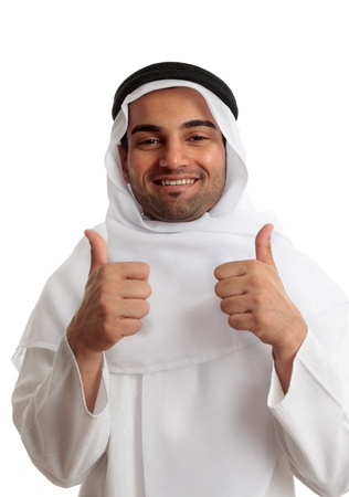 headress: Ethnic man giving a thumbs up approval.  He is wearing cultural clothing, white thawb, ghutra and double black rope called an Igal.   Modern arab where the headress in a variety of ways as a fashion statement
