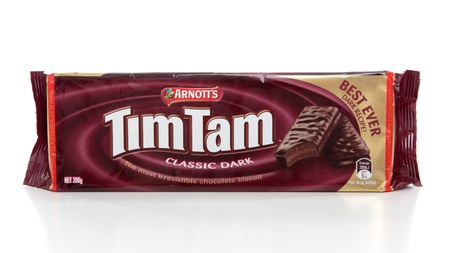 Packet of Tim Tams - biscuits made by Arnott's Biscuits, Australia. comprising two layers of chocolate malted biscuit,  a light chocolate cream filling, and coated in a thin layer of chocolate. Named by Ross Arnot after the winning horse at Kentucky Derby Stock Photo - 8728267
