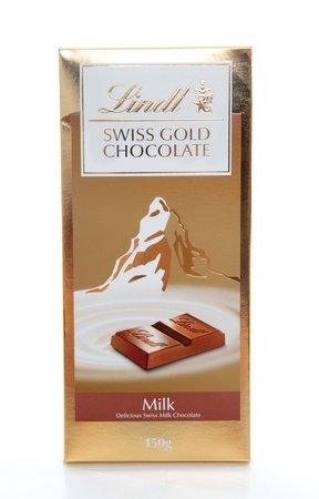 Lindt premium Swiss Gold chocolate bar 100grams.  Milk chocolate.  Editorial Use Only.  White background. Stock Photo - 8728270