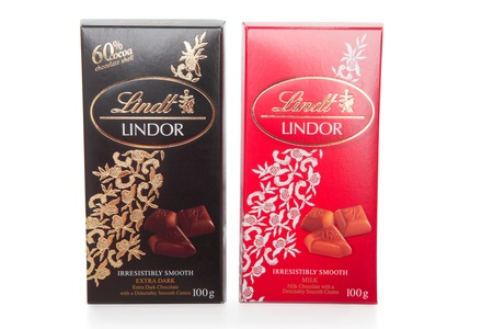 Lindt Lindor premium chocolate bars 100gram.  Milk and Extra Dark with smooth centres.  White background.  EDITORIAL USE ONLY. Stock Photo - 8728275