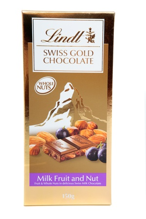 lindt: A block of Lindt Swiss Gold premium chocolate 100g with fruit and whole nuts.  White background.  EDITORIAL ONLY.