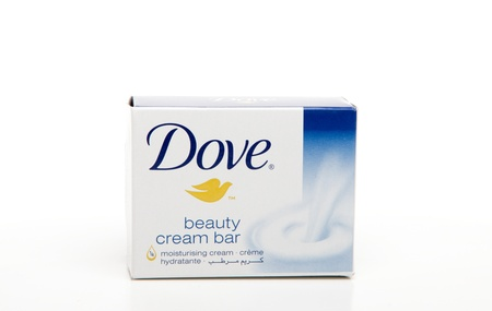 Dove cream soap bar.  Dove soap with 1/4 moisturizing lotion hydrates and nourishes skin.  Dove is manufactured by Unilever.  White background.  Editorial use Only. Redactioneel