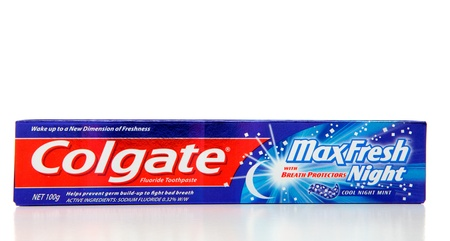 fluoride: Colgate Max Fresh Night, cool mint fluoride toothpaste 100g.  Colgate has been around since 1806. White background.  Editorial Use Only.