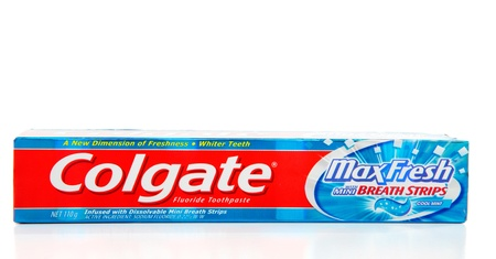fluoride: Colgate Max Fresh toothpaste with contains fluoride and breath strips that dissolve and freshen breath.  White background.  Editorial use only.