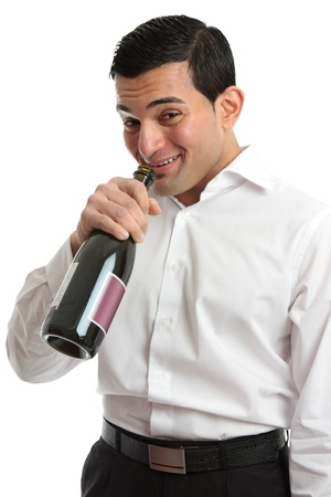 tipsy: A tipsy or drunk man party goer drinking directly from a wine bottle