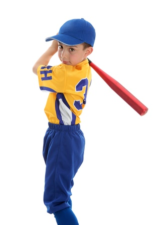 A young boy swings a baseball bat.  White background. photo