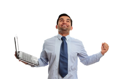 clenched: An excited man holding a laptop and raising arm in clenched fist and looking upward celebrates victory, achievement or success.