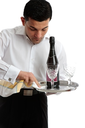 A waiter or servant at work.  White background. photo