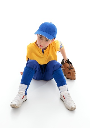 A young boy dressed in baseball tball sports clothing and wearing a leather glove mitt.  Sitting on white background.   photo