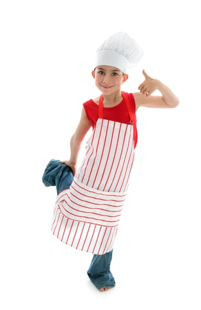 A young child chef wearing a red and white striped apron and white chef hat smiling and thumbs up   White background. Stock Photo - 8885922