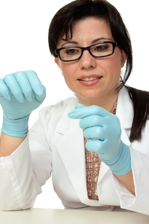 Crime scene investigator or forensic criminologist expert holding a fingerprint sample exposed with latent powder and lifted with tape.  White background. Stock Photo - 8885934
