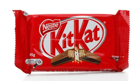 Nestle Kit Kat chocolate coated cream filled wafer snack.  45g  980kj    First created by Rowntrees of York, England, and now produced worldwide by Nestlé since 1988.  In the United States it is made under licence by Hershey Company.