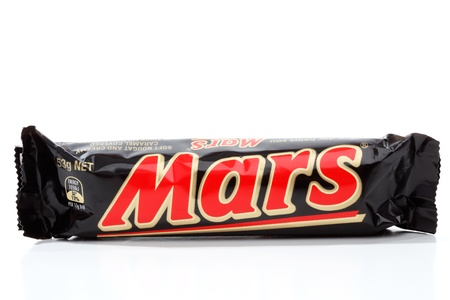 confectionary: Mars bar, soft nougat, caramel and chocolate coated snack bar.  Manufactured by Mars Inc.  53g   1050kj  White background.  Editorial Use Only.