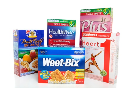 A selection of various boxed healthy breakfast cereals foods.  White background, EDITORIAL USE ONLY.