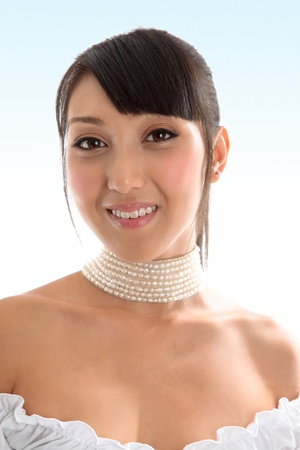 A beautiful young girl with bare shoulders and wearing a choker necklace.Model  Jessica Elms  (n.b. new model  would like some tearsheets of images in use,if you are able to forward a proof or final layout or weblink, please contact me)  Makeup by Hanae Stock Photo - 9013495