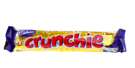 pokey: Cadbury Crunchie chocolate and golden hokey pokey honeycomb bar.  Shown 50g (995kj)   Crunchie bar is available in 50g, 80g, 216g Share Packs and 18g Special Treats pieces.  White background.  Editorial Use Only. Editorial
