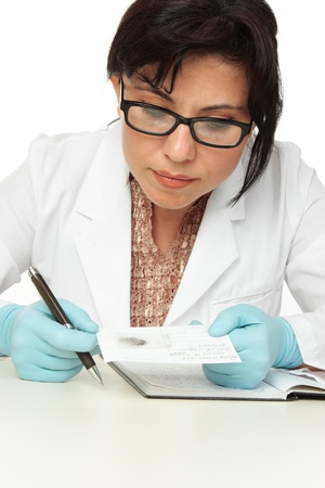 criminologist: A forensic scientist or criminologist holding a fingerprint and fingerprint forensic card.