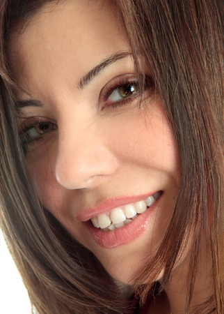 closely cropped: A closely cropped face of a beautiful brunette woman smiling and looking at camera. Stock Photo