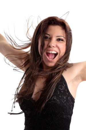 exuberant: A lively happy woman with long hair showing excitement and happiness.   There is some movement motion to some parts of her hair and mouth.  White background.