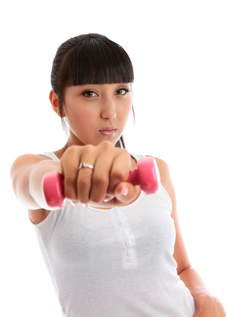 Beautiful young mixed race girl at the gym using hand weights.  She is looking directly at camera isolated on a white background. Stock Photo - 9013564