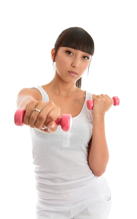 A fit and healthy young woman exercising with hand weights.  White background.   Stock Photo - 9013563