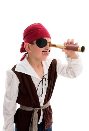 A young boy pirate looking through a monoscope in search of treasure or ships to plunder.  White background. Banque d'images
